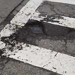 Pothole at Intersection Of Irving St & Revere St
